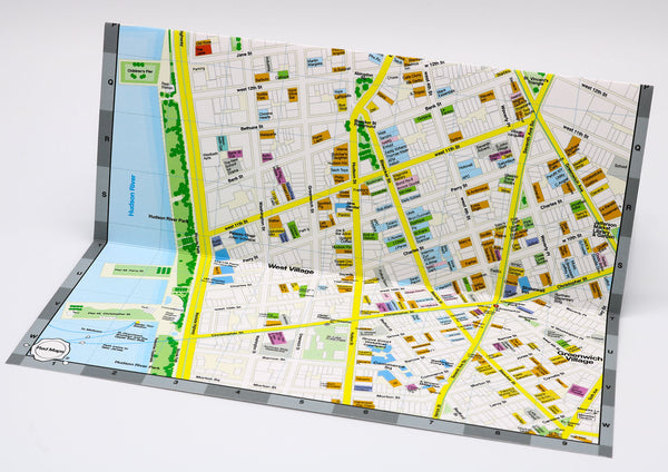 Foldout map showing NYC's West Village neighborhood located south of Chelsea, with restaurants, cafes, local merchants, architectural landmarks and the subway.