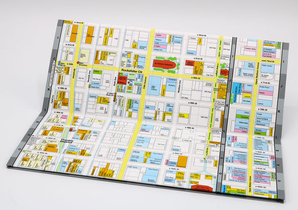 Foldout Midtown NYC map with block-by-block detail of restaurants, Broadway theatres, hotels, museums, and cafes near St Patricks Cathedral.