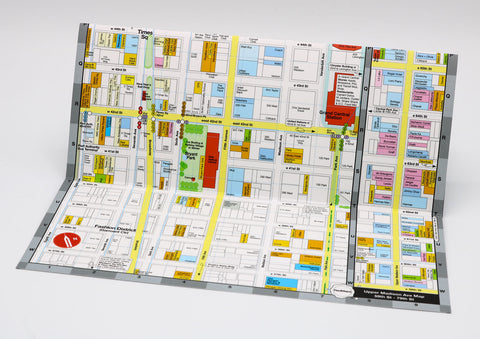 foldout shopping map of Midtown Manhattan showing the designer boutiques and popular restaurants