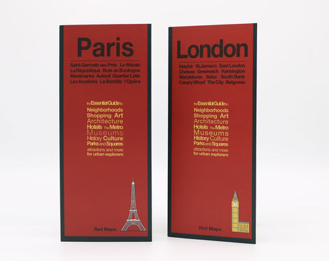 A London map with a red cover and an image of Big Ben, and a Paris map with a red cover and an image of the Eiffel Tower.