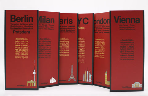 Six city maps with red covers, including Berlin, London, Paris, Vienna, NYC and Milan.