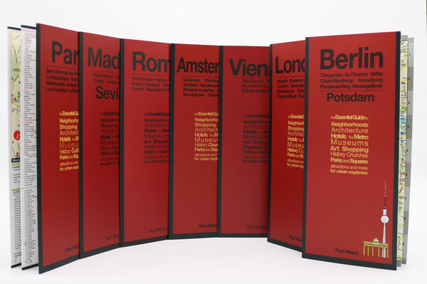 Seven foldout city maps with red covers to Madrid, Amsterdam, Vienna, Berlin, Paris, London and  Rome