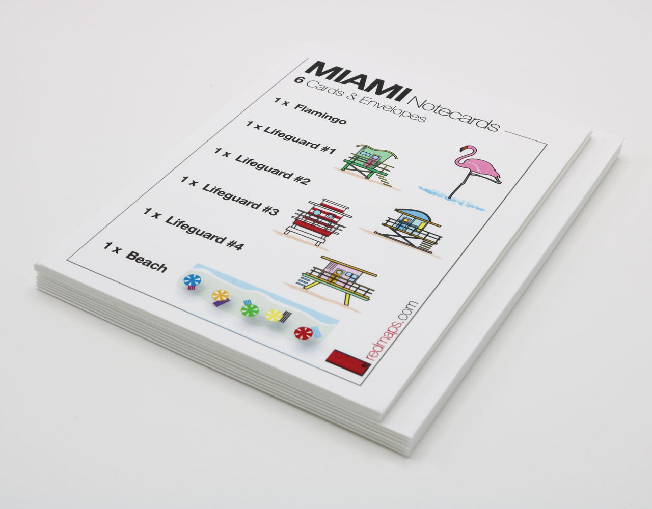 Miami-themed stationery with drawings of colorful lifeguard stations, Flamingo and beach umbrellas