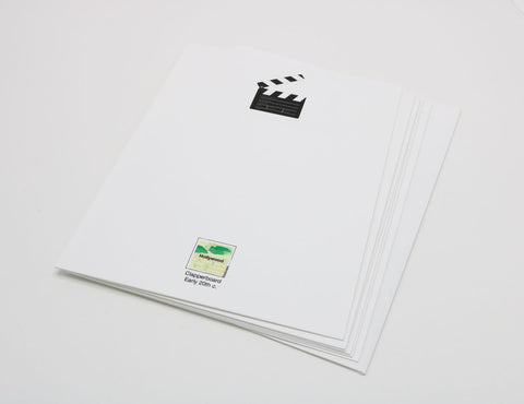 white notecard that has an image of a film set clapperboard.