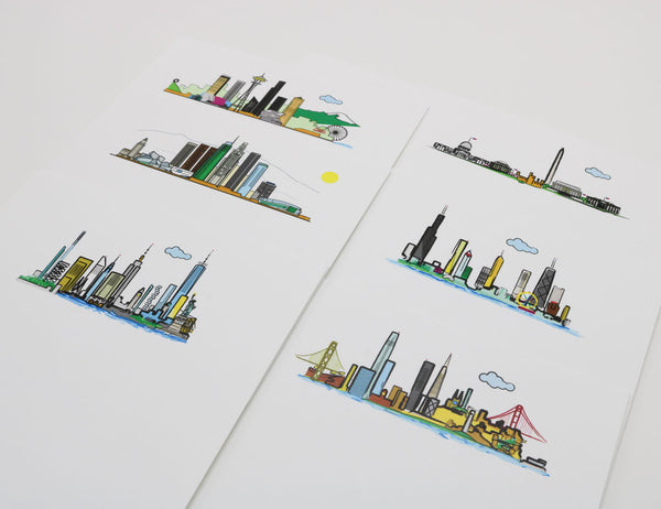 Notecards with cartoonish drawing of American city skylines San Francisco, Seattle, Washington DC