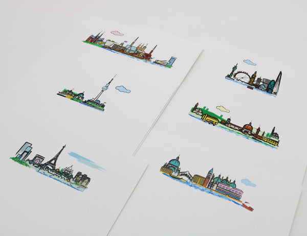 Notecards with cartoonish images of European city skylines