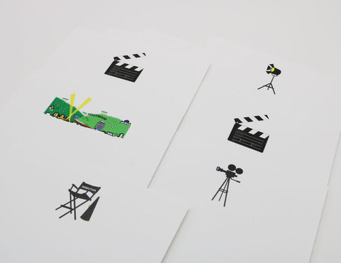 Hollywood themed stationery with images of Hollywood clapperboards, set lamps and director's chair.