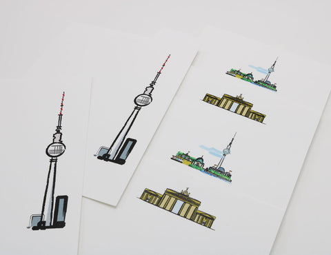 white stationery with images of Berlin's famous landmarks including Brandenburg Gate and Fernsehturm Tower.