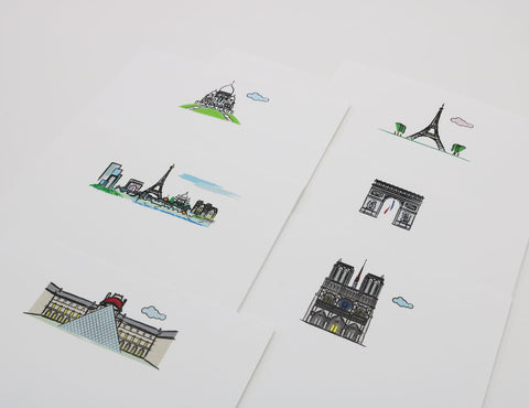 Set of white notecards that have images of famous Paris landmarks.