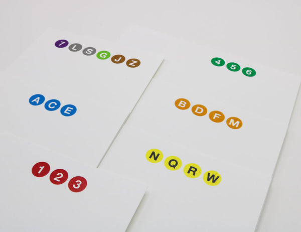 Notecards with drawings of NYC Subway symbols, colors, subway letters and numbers