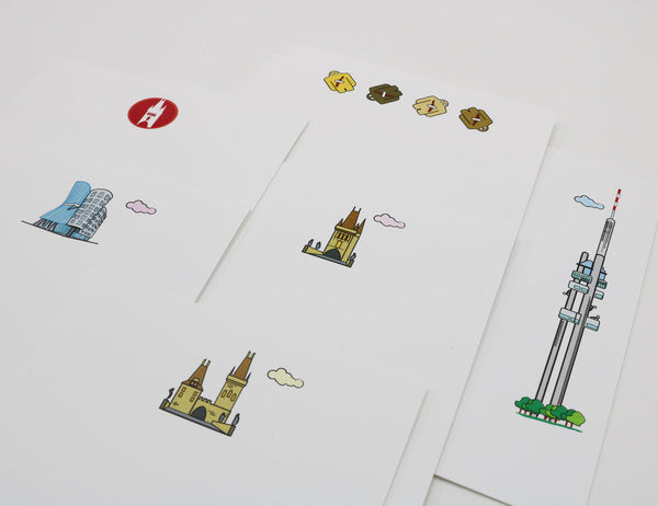 Notecards with cartoonish drawings of Prague landmarks, Charles Bridge Towers, Dancing House and Prague Golem