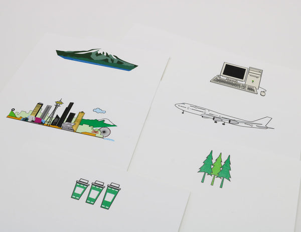 Notecards with cartoonish drawings of Seattle landmarks and icons, coffee cups, Space Needle, Mt. Rainier, passenger jets, computer