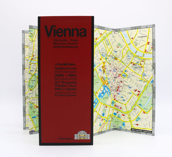 Foldout map of central Vienna showing museums, historic buildings, antiques district, tram and metro stations and routes.