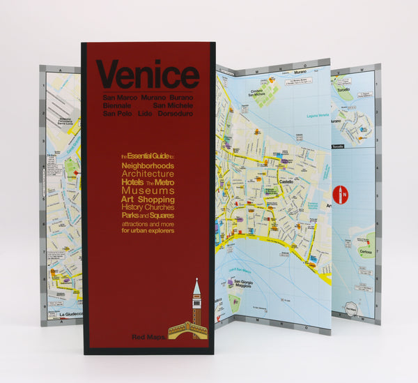 Foldout Venice map with landmarks, historic churches, and popular attractions and water taxi stations and routes.