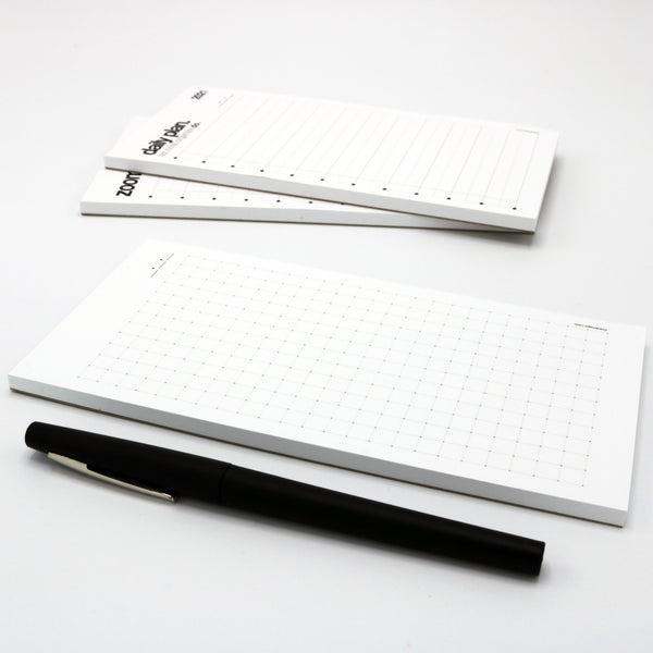 pocket-sized graph-lined notepad