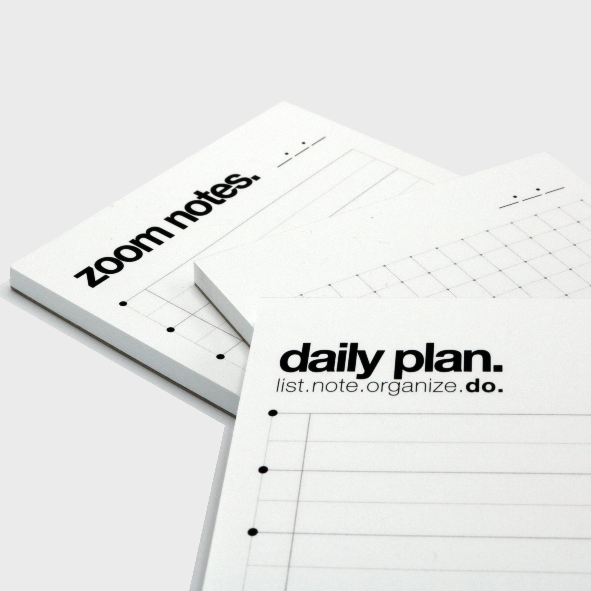 three fine-lined pocket-sized notepads