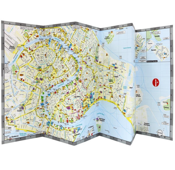 Foldout map of Venice Italy that shows historic landmarks, architecture, museums, vaporetto and water taxi stations.