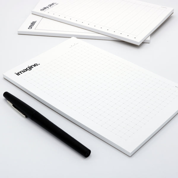 grid-lined drawing notepad