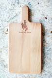 Jackson Hole buscking bronco decorated cutting board with handle