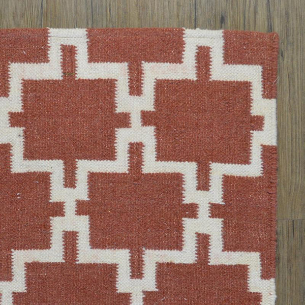rust coloured wool rug