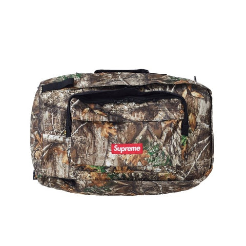 SUPREME DUFFLE BAG REAL TREE CAMO FW19