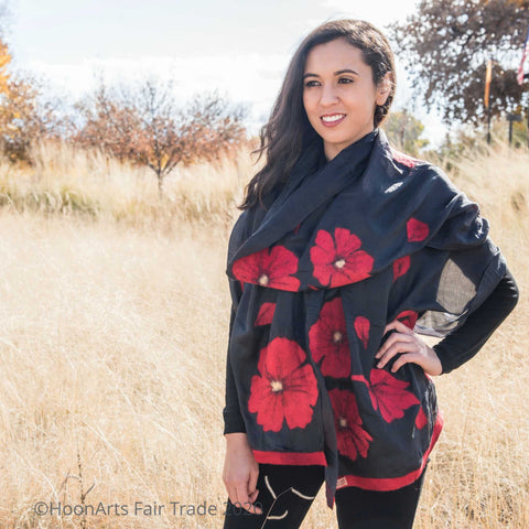 Handmade felted silk scarf from Kyrgyzstan, large red felted poppies on black silk, on young Latinx female model