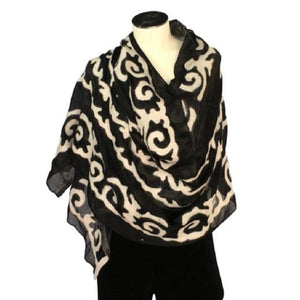 White and black Kyrgyz felted shawl with traditional patterns