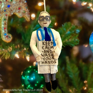 "Dr. Fauci, everyone's new pandemic hero, handmade felt Christmas ornament with white lab coat, blue tie and signature glasses, holding up a sign saying ""Keep Calm and Wash Your Hands"""
