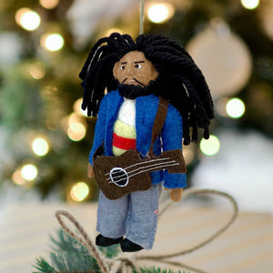 Handmade Felt Ornament of Bob Marley with Guitar, against a Background of Blurred Christmas Lights