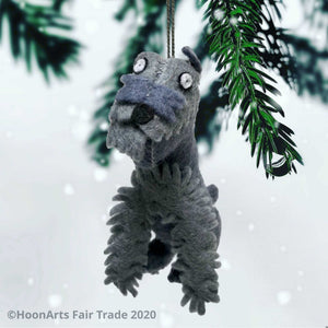 Miniature Schnauzer Felt Christmas Ornament, hanging against a white background from a pine Christmas tree