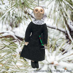 Ruth Bader Ginsburg Handmade Felt Ornament, Dressed in Black Judicial Robes with White Color, Wearing Her Signature Large Eyeglasses, Handing from a Snow-Covered Pine Tree