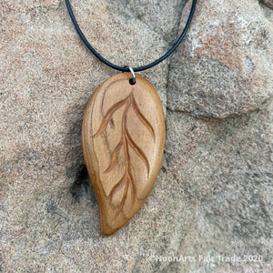 Small Hand Carved Apricot Wood Pendant from Tajikistan