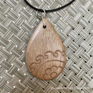 Small Hand Carved Walnut Pendant from Tajikistan