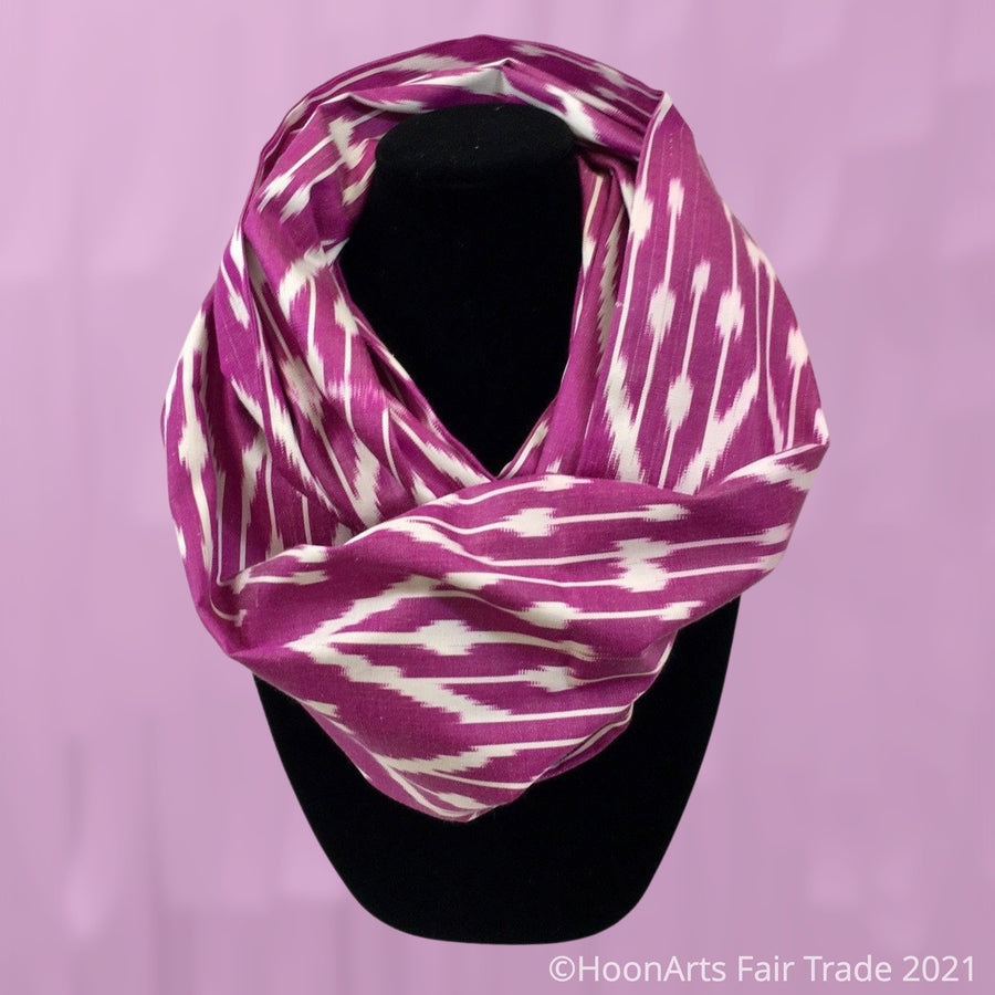 Handwoven Uzbek silk ikat infinity shawl in hot pink and white traditional pattern, draped on mannequin | HoonArts