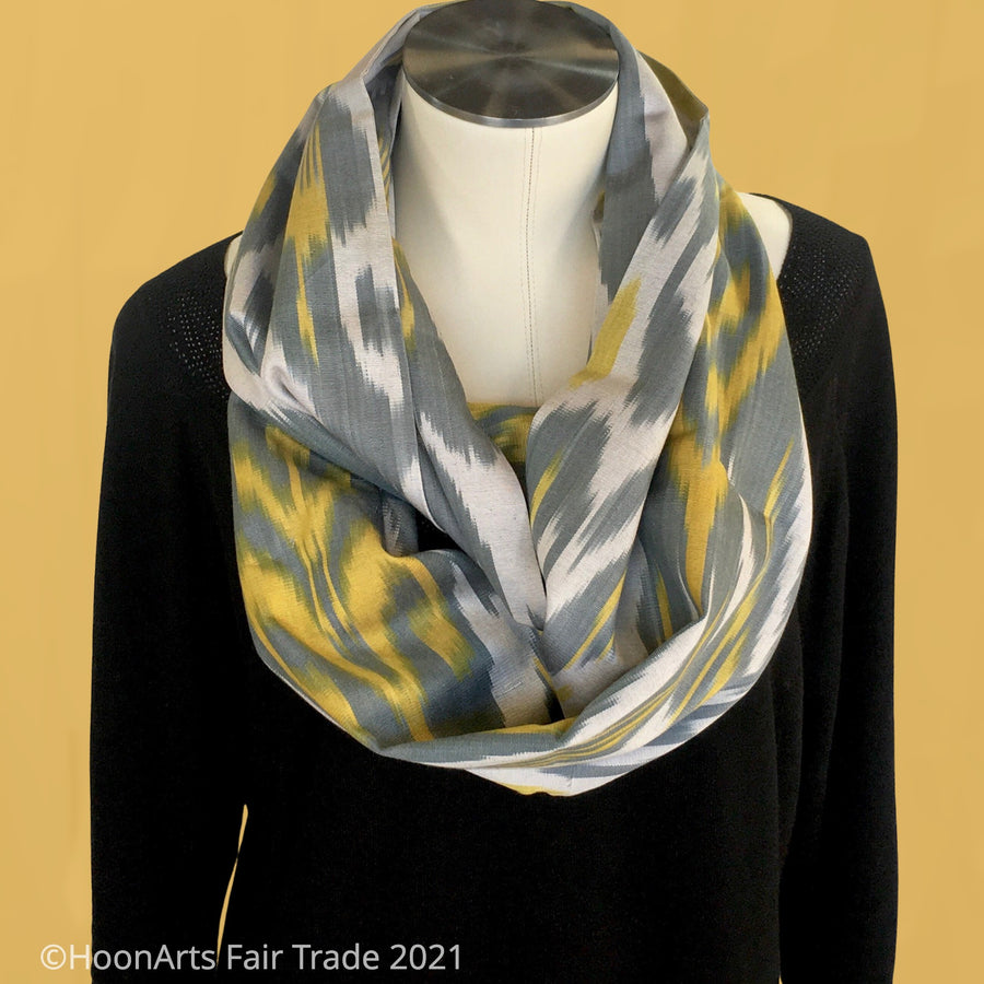 Handwoven Silk & Cotton Ikat Infinity Shawl-Yellow, Grey and Silver Traditional Uzbek pattern, draped on mannequin