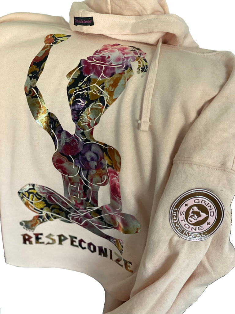 Pink hoodie with a woman holding her fist up. Headwrap and Respeconize floral