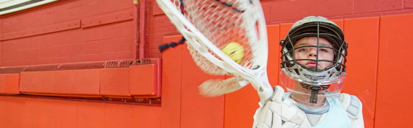 Lacrosse goalie training indoors using a Swax Lax Goalie training ball