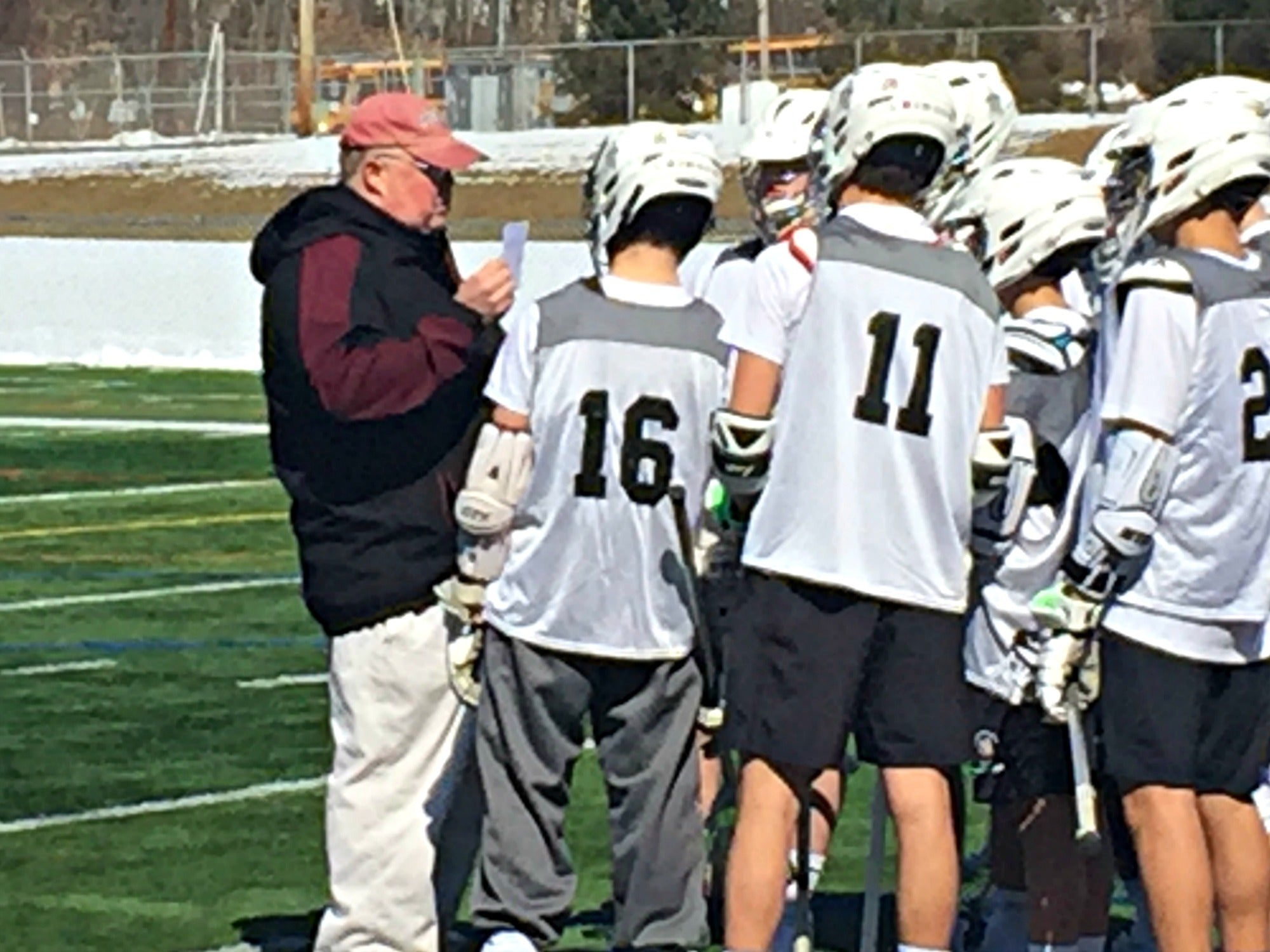 Coach Kevin talking to his team about posiions