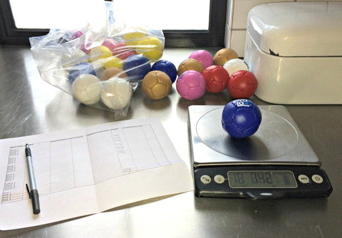 Weighing Swax Lax Lacrosse Training Balls for Quality Control