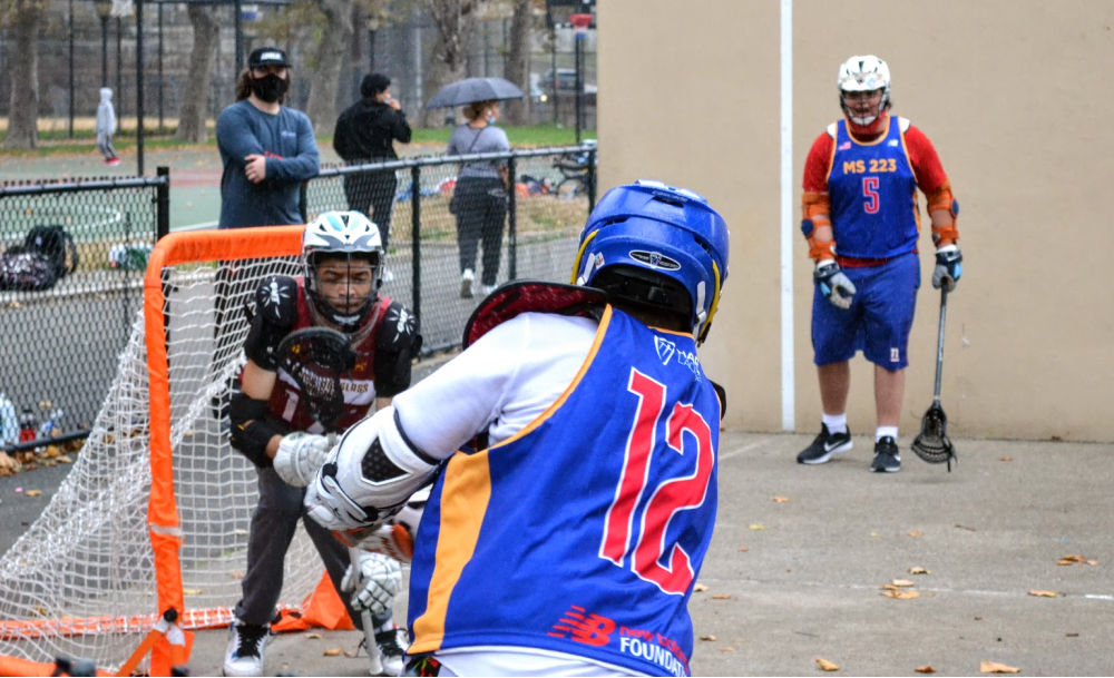 Boys from Harlem Lacrosse practicing lacrosse drills