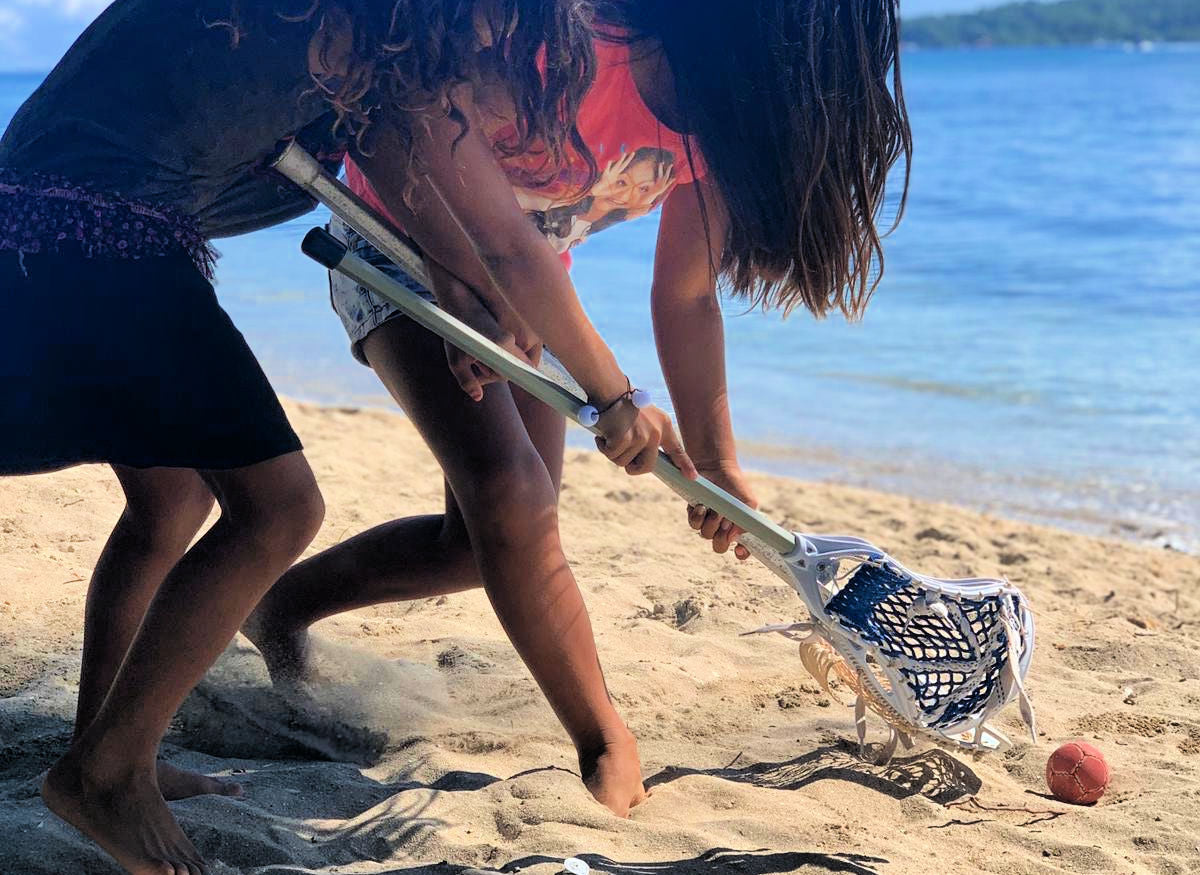 Lacrosse the Nations girls playing lacrosse on the beach