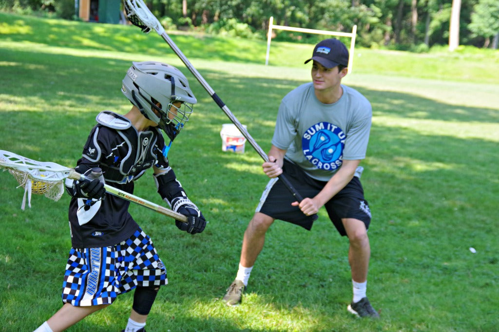 Lacrosse coach teaching defense