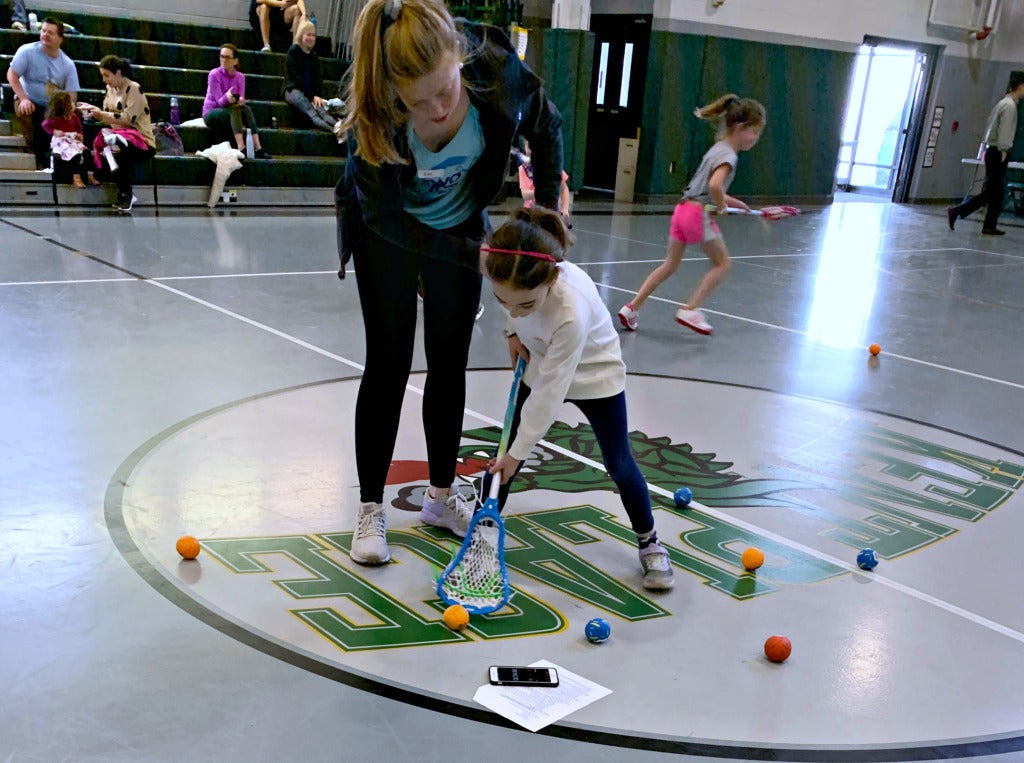 Coach Eve breaks down how to properly pick up ground balls during Swax Lax Lacrosse indoor clinic