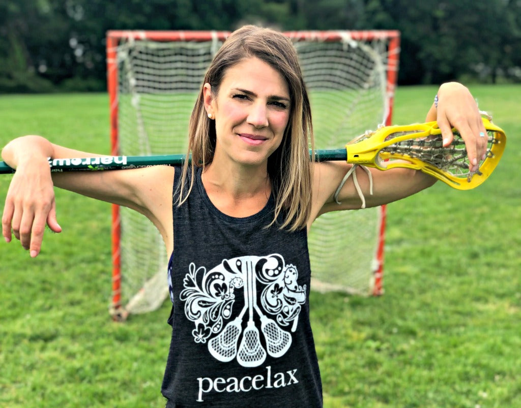 Dara Packer who is a girls club lacrosse coach, creative designer, and co-founder of PeaceLax