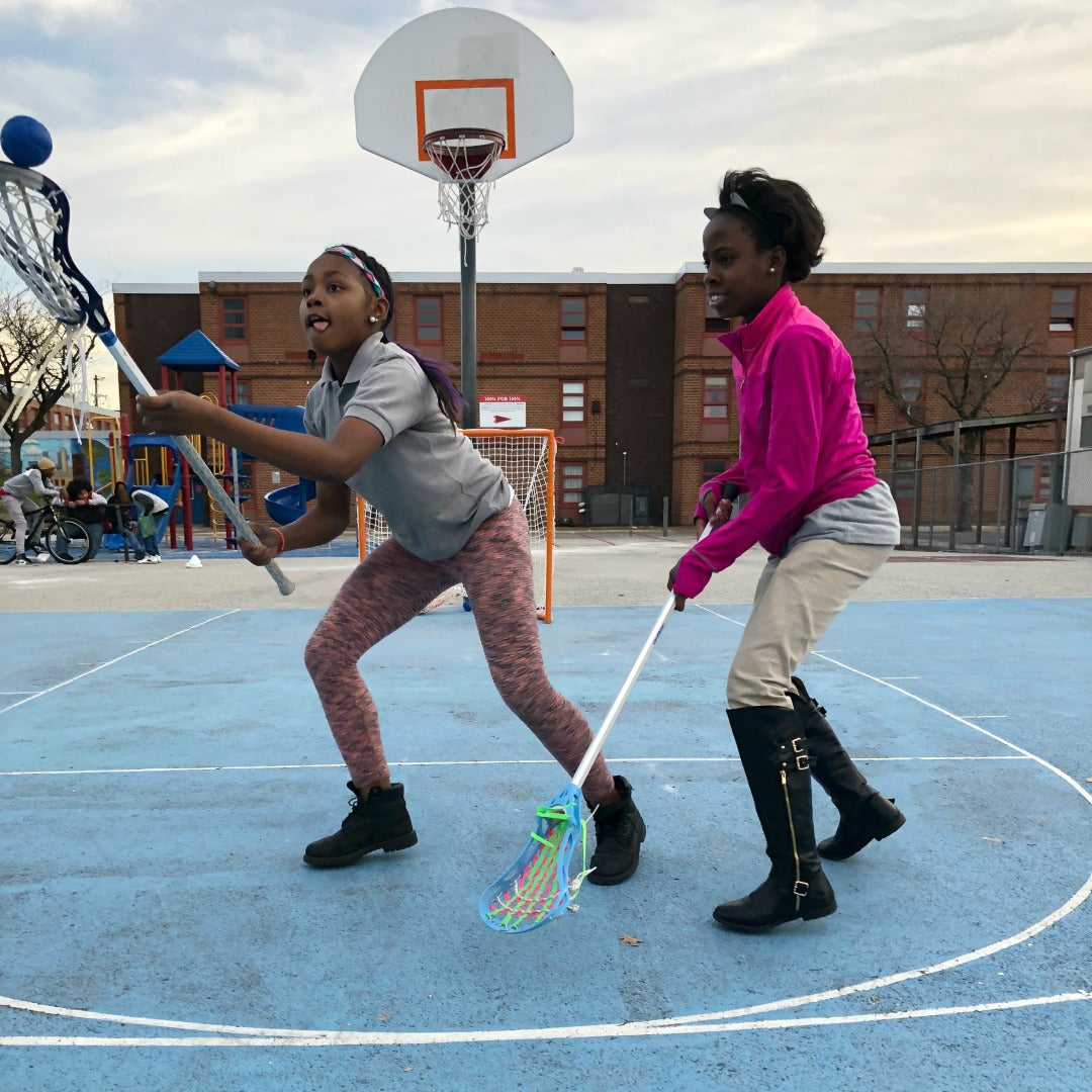 Harlem Lacrosse girls having fun practicing lacrosse outdoors using Swax Lax soft lacrosse training balls