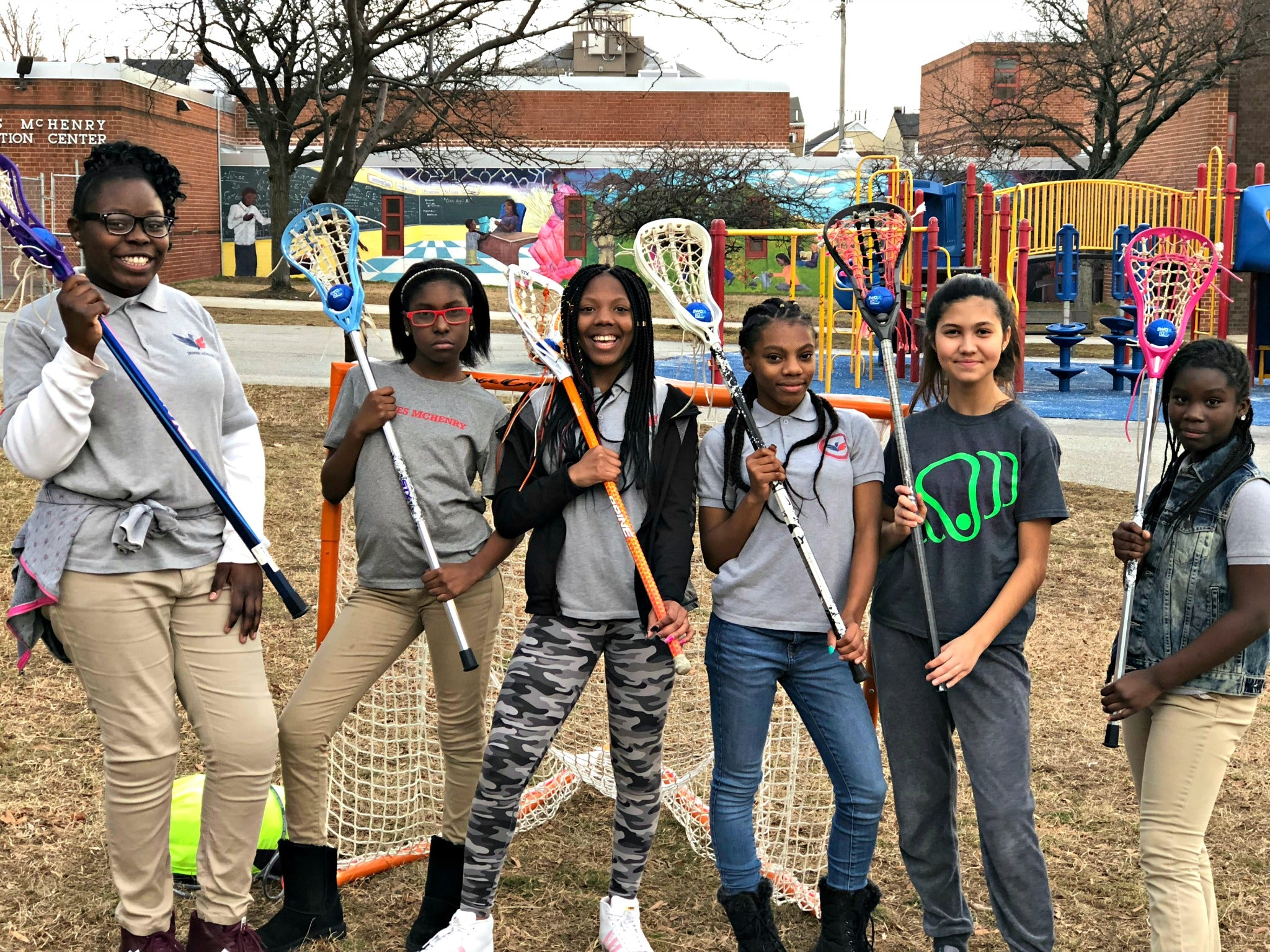 Group photo of Harlem Lacrosse players using Swax Lax soft lacrosse training balls