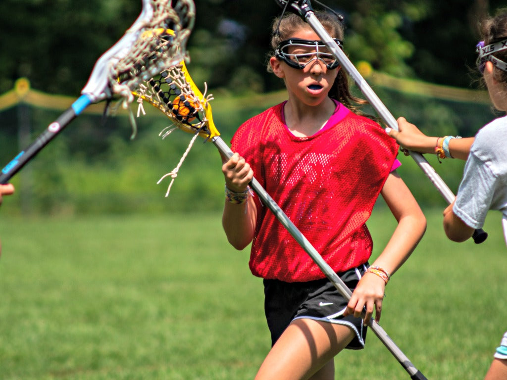 Girls practicing lacrosse using a Swax Lax lacrosse training ball, no bounce, no roll