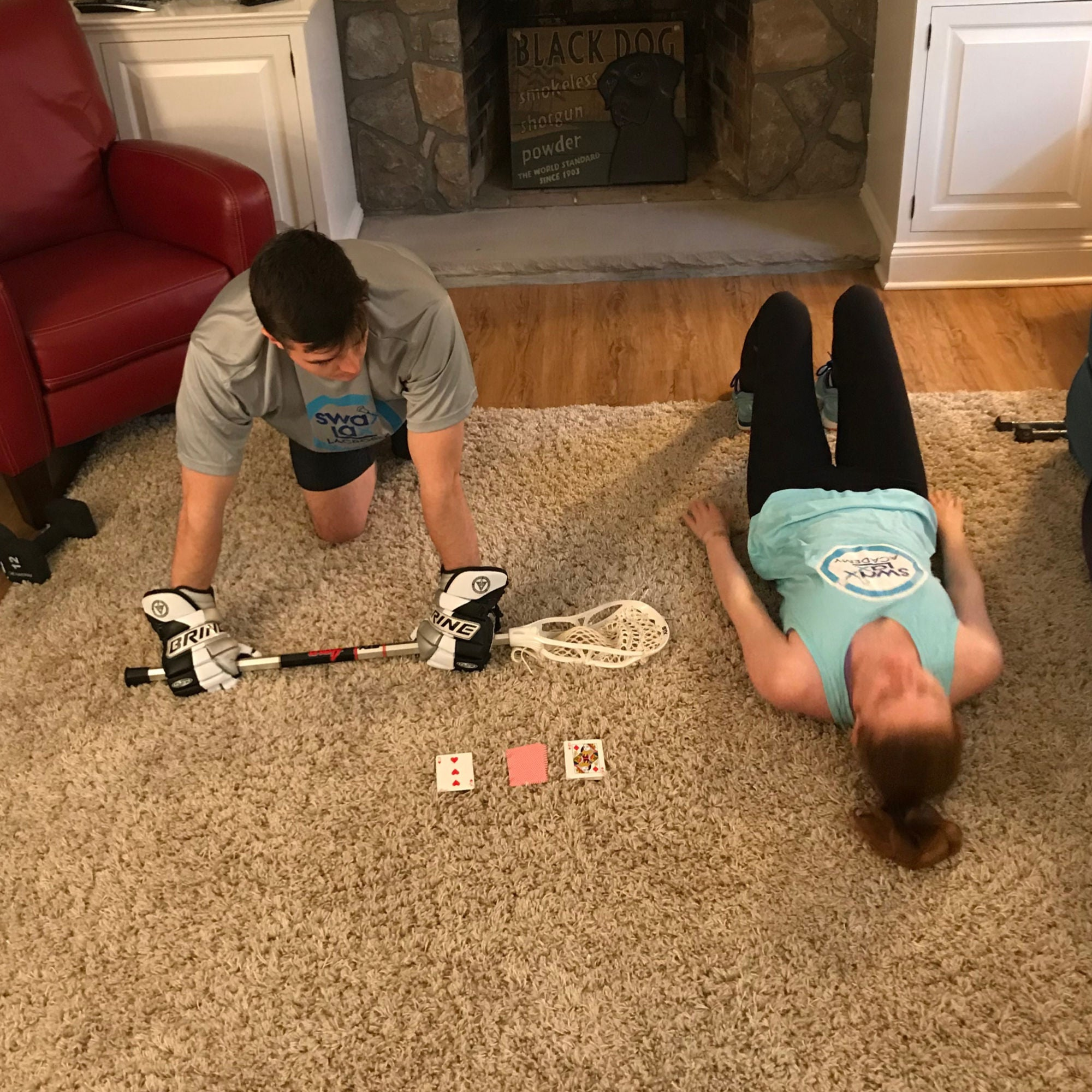 Lacrosse coaches Brian and Liza staying in shape and training using playing cards as prompts