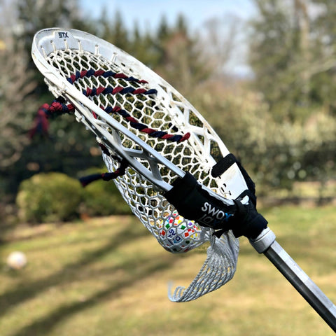 Swax Lax Power Weights shown on goalie lacrosse stick - side view