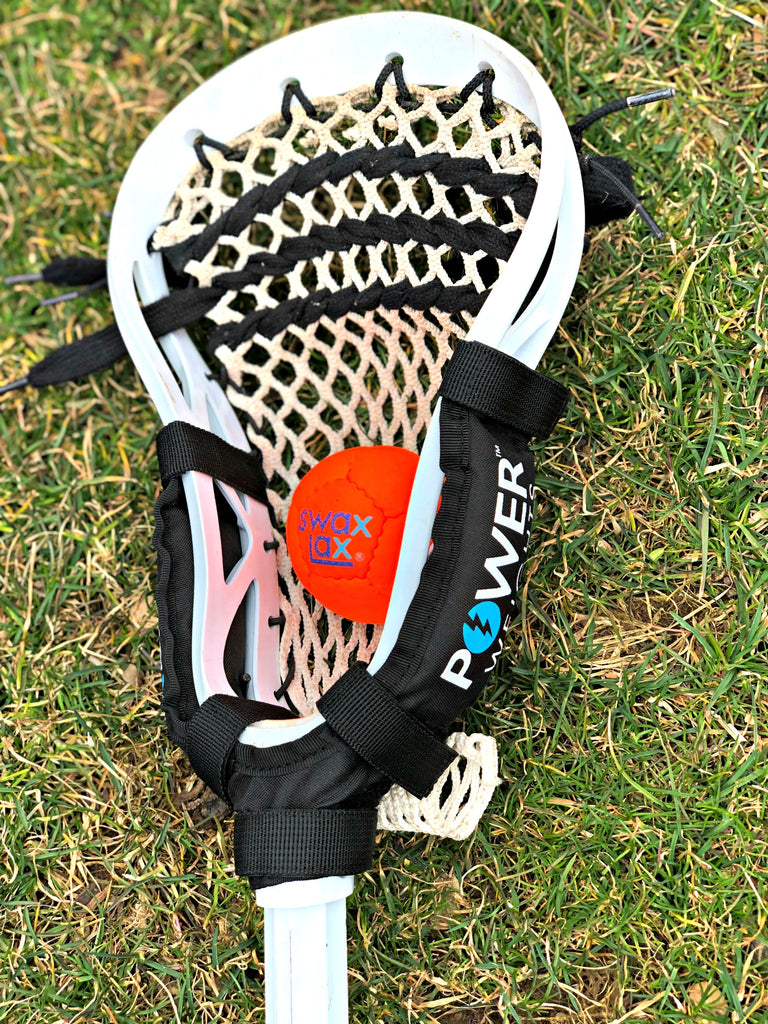 Swax Lax Power Weights on boy's lacrosse stick